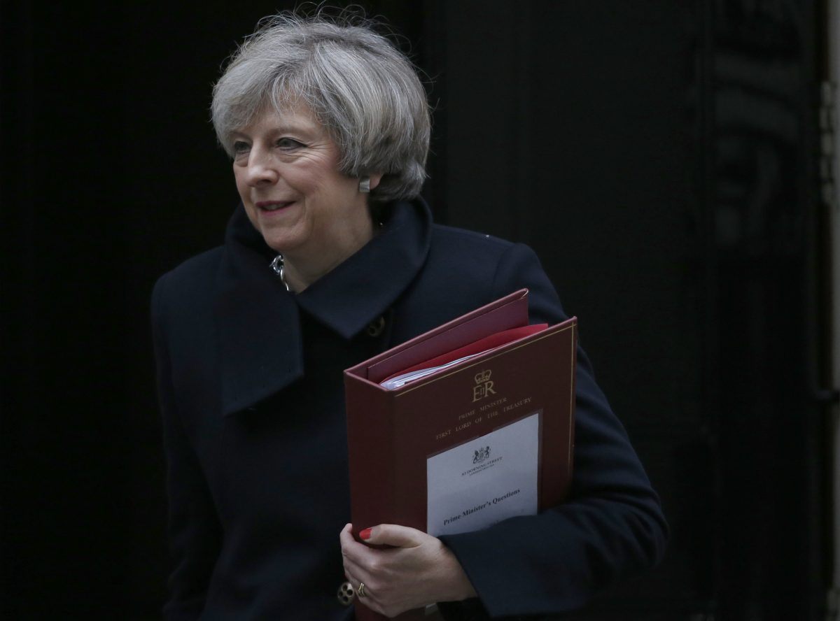 Britain's Prime Minister Theresa May leaves 10 Downing Street for the House of Commons for her weekly Prime Ministers Questions, in London, Wednesday, Feb. 8, 2017. (AP Photo/Alastair Grant)