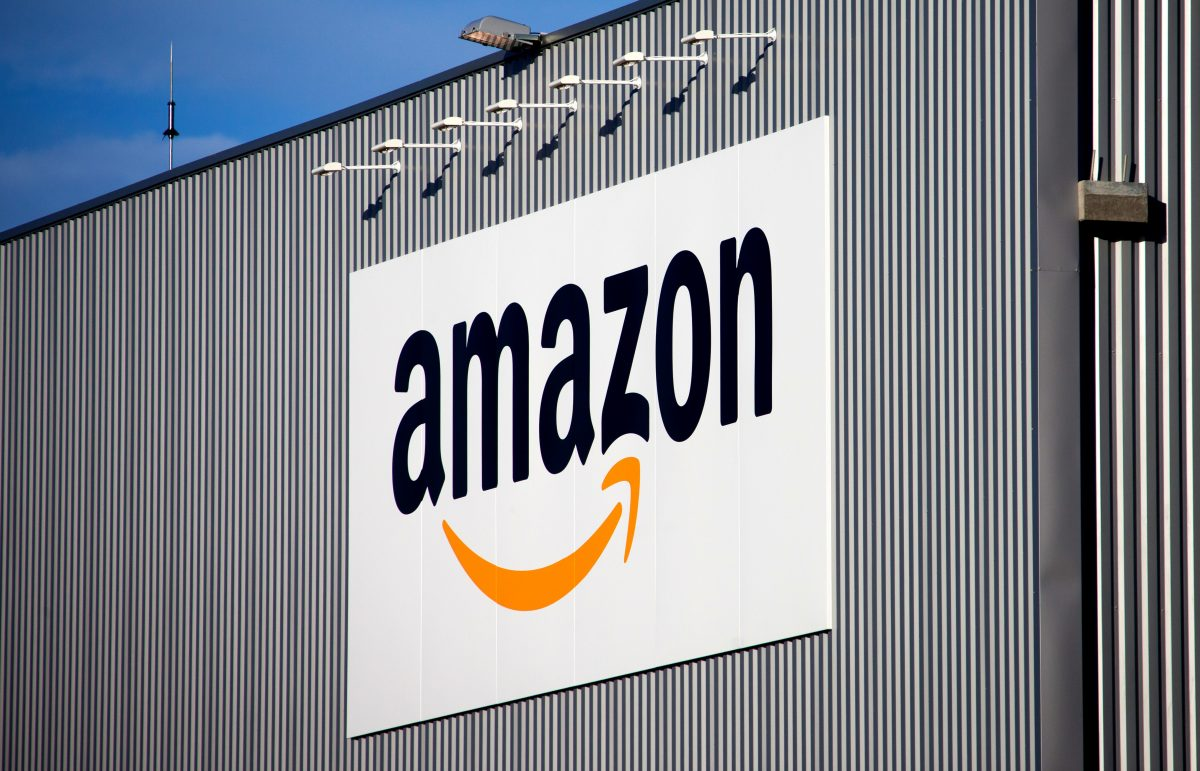 FILE - This Sept. 19 2013 file photo, the Amazon logo is seen on the new logistics center of online merchant Amazon in Lauwin-Planque, northern France. French economy minister Bruno Le Maire has launched a lawsuit against American e-commerce giant Amazon for imposing unfair commercial relationships to suppliers in the country. (AP Photo/Michel Spingler, File)
