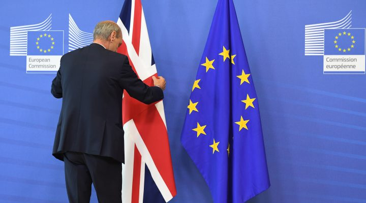 A member of protocol adjusts the British flag prior to the arrival of British Prime Minister David Cameron at EU headquarters in Brussels on Tuesday, June 28, 2016. EU heads of state and government meet Tuesday and Wednesday in Brussels for the first time since Britain voted to leave the European Union, throwing British and European politics into disarray.